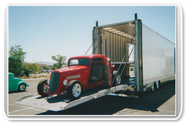 Classic Car in Enclosed Car Transporter