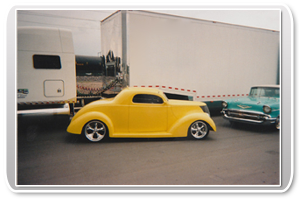 Classic Car with Enclosed Car Transporter